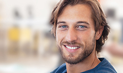 Happy young man who knows how employer 401k matching grows his retirement