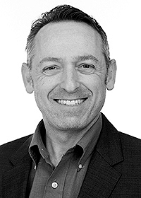 Black and white picture of Erick Brickman, Chief Solutions Officer