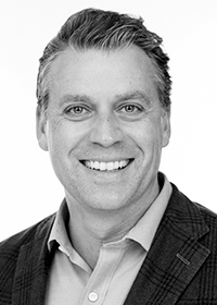 Black and white picture of Greg Tschider, Newport CEO