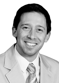 Black and white picture of Scott Pollack, EVP Client Services